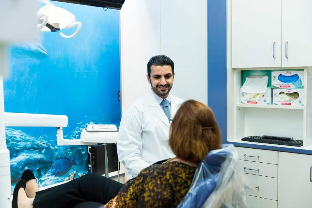 seacliff dental dr sam Soltani with dental patient
